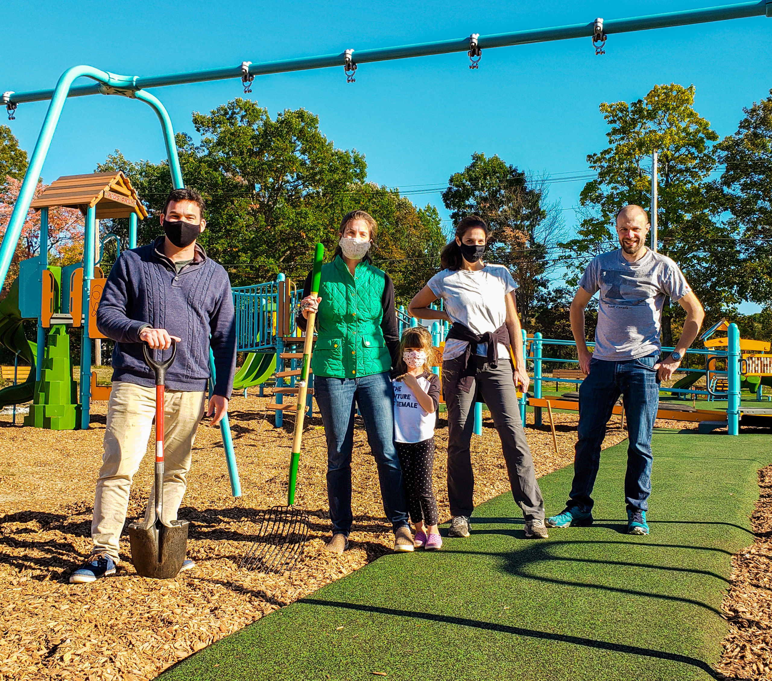 Rep. Sena helps local Acton families fill in the new Jones Playground in Acton, MA