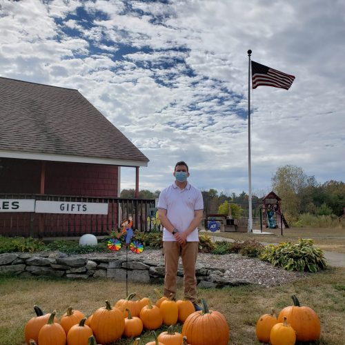 Rep. Sena stands outside Westward Orchards in Harvard, MA during a district tour