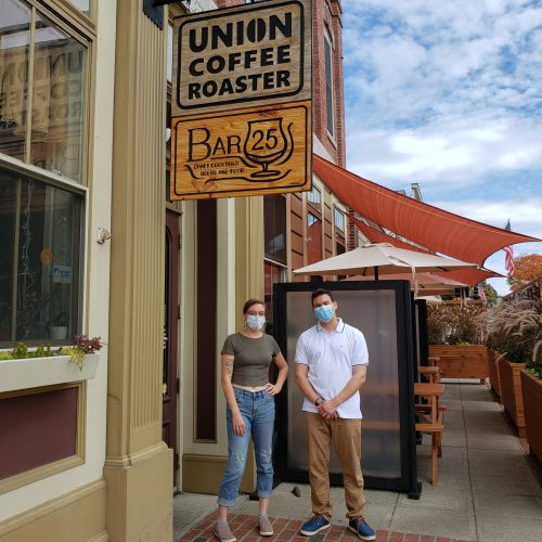 Carrie and Rep. Sena stand outside Union Coffee Roaster, in Ayer, MA